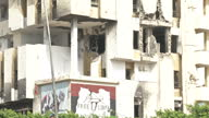 Exterior shots Libya streets bulletdamaged buildings and posters on July 03 2012 in Az Zawiyah Libya