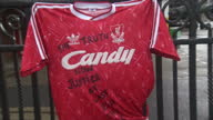 Exterior shots Liverpool FC shirt with 'The Truth Now Justice at Last RIP The 96' written in black pen on the front Exterior shots people arrive to...