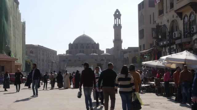 Exterior shots locals tourists Muslim people milling outside Al Hussein Mosque on February 2 2016 in Cairo Egypt