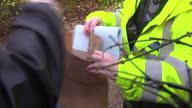 Exterior shots man handing a police officer grey sock Man Handing Police Officer A Grey Sock on September 29 2011 in Bristol England