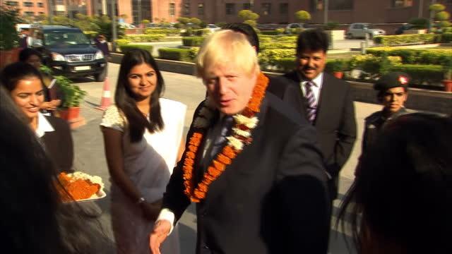Exterior shots Mayor of London Boris Johnson welcomed to Amity University presented with several garlands by ladies Boris Johnson Welcomed in Noida...