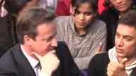 exterior shots medium close of David Cameron sits talking with Bollywood actor Aamir Khan surrounded by students David Cameron with Aamir Khan Delhi...