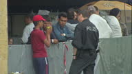Exterior shots migrants refugees asylum seekers in temporary refugee camp in Passau Lower Bavaria on September 03 2015 in Passau Germany