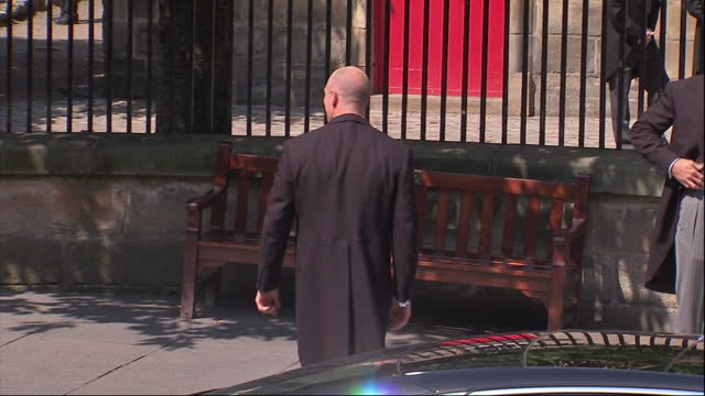 Exterior shots Mike Tindall gets out of car waves to cheering crowds walks over to the church entrance with the best man greets guests Mike Tindall...
