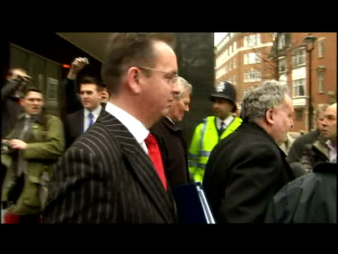 exterior shots MPs David Chaytor Jim Devine walk from court to waiting taxi It is expected another politician will find out if they'll be charged in...
