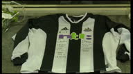 Exterior shots Newcastle shirts with messages on them left in tribute to Gary Speed Exterior shots Everton shirts left in tribute for Gary Speed...