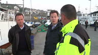 Exterior shots Nick Clegg Deputy Prime Minister Leader of Liberal Democrat Party on walkabout around port with harbour master on April 21 2015 in...