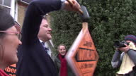 Exterior shots Nick Clegg Liberal Democrat leader struggling to hammer 300th Lib Dem election stake board into ground He jokes 'I've been told to...