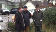Exterior shots Nigel Farage on visit to flood affected areas of Chertsey standing talking next to small puddle on in Chertsey United Kingdom