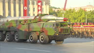 Exterior shots North Korean Taepodongclass missiles are displayed on back of military vehicles during Workers Party 70th Anniversary Military Parade...