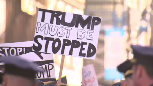Exterior shots NYPD police officers policing crowds of protesters outside Trump Tower protesting against Donald Trump being elected US President on...