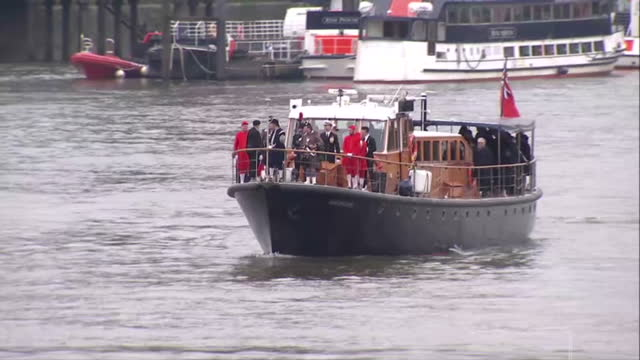 Exterior shots of a barge on the River Thames taking part in a wreath laying event to mark 50 years since the funeral of Winston Churchill with...