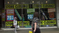 Exterior shots of a BHS store on Oxford Street with 'Store Closing' signs in windows and shoppers passing on July 25 2016 in London England