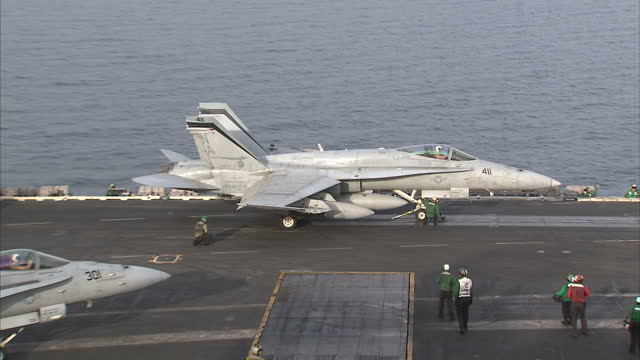 Exterior shots of a Boeing F/A18E Super Hornet taking off from the USS Carl Vinson on April 04 2015 in At Sea UNSPECIFIED Region UNSPECIFIED