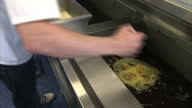 Exterior shots of a Chef in a fish and chip shop deep frying a Mars Bar on October 20 2013 in Stonehaven Scotland