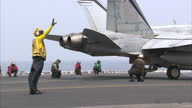 Exterior shots of a F/A18C Hornet from Strike Fighter Squadron VFA94 aka 'Mighty Strikes' taking off from USS Carl Vinson on April 04 2015 in At Sea...