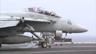 Exterior shots of a F/A18F Super Hornet of Strike Squadron 22 aka'Fighting Redcocks' taking off from the USS Carl Vinson on April 04 2015 in At Sea...