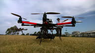 Exterior shots of a fire drone for use on bush fires being operated by firefighters in a test area Fire Drones Being Operated by Firefighters on...