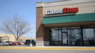 Exterior shots of a Game Stop location in Peru Illinois GameStop signage sits above the entrance to their location in Peru Illinois as cars and...