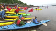 Exterior shots of a group of environmental activists in kayaks in Seattle harbour in a protest against a plan by oil giant Shell to drill in the...