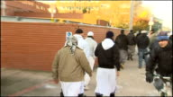 Exterior shots of a group of Muslim men departing from Luton Magistrates Court including Jabair Ahmed Ibrahim Anderson Shajjadar Choudhury Ziaur...