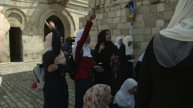 Exterior shots of a group of Muslim women protesting outside the entrance to the Temple Mount compound demonstrating their anger against Israeli...