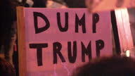 Exterior shots of a large crowd of anti Donald Trump protesters in Cardiff with 'Love Trumps Hate' 'Dump Trump' banners and the like on January 30...