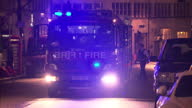 Exterior shots of a London Fire Brigade Fire Engine as it drives down a road responding to a 999 emergency call on January 13 2011 in London England