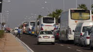 Exterior shots of a long queue of traffic including tourist coaches and cars waiting to get into Sharm el Sheikh airport after security concerns led...
