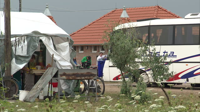 Exterior shots of a refugee camp refugees taking a rest in large tents on August 25 2015 on the border between Serbia and Hungary