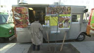 Exterior shots of a roadside curry and kebab van vendor in Manhattan serving street food to customers on December 05 2012 in New York City