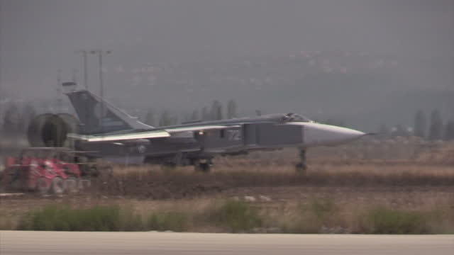 Exterior shots of a Russian air force Sukhoi Su25 Fencer taking of from Latakia airbase on December 21 2015 in Latakia Syria