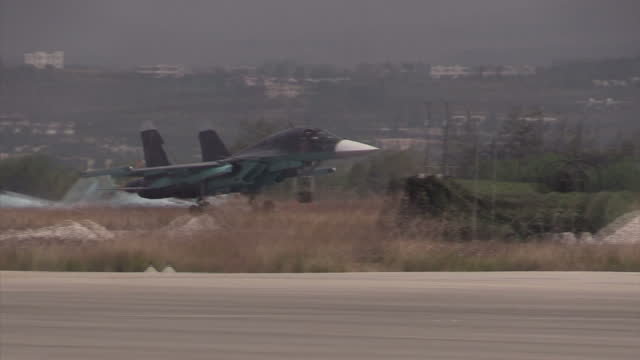 Exterior shots of a Russian air force Sukhoi Su34 Fullback jet landing at Latakia airbase on December 21 2015 in Latakia Syria