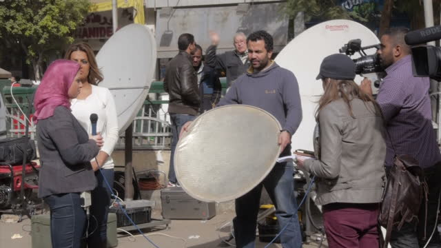 Exterior shots of a scrum of reporters and camera crews outside Cairo High Court during the retrial of three Al Jazeera journalists on January 01...