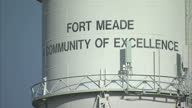 Exterior shots of a sign for Fort Meade and a water tower bearing the name of the army base on December 16 2011 in Fort Meade Maryland