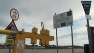 Exterior shots of a sign on a fishing port declaring that funding for the project came from the EU on 16 August 2017 in North Shields United Kingdom