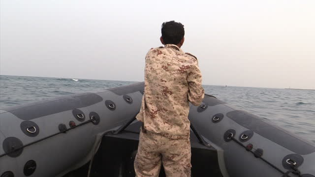 Exterior shots of a small boat patrolling the coast for illegal people smuggling on June 13 2015 in Zuwarah Libya