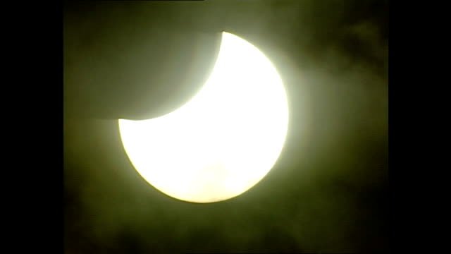 Exterior shots of a solar eclipse over Kruger National Park as people watch it through special viewers on December 04 2002 in Krugersdorp South Africa