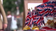 Exterior shots of a stall selling Union Jack flags and other souvenirs near the Adlon Hotel and Brandenburg Gate during the Queen's state visit to...