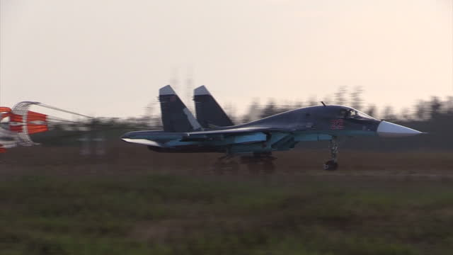 Exterior shots of a Sukhoi Su34 Fullback fighter bomber landing at Latakia airbase after flying sorties over Syrian opposition forces on December 21...