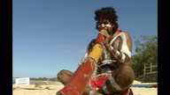 Exterior shots of a traditional Aboriginal dance being performed on a beach on Australia's Gold Coast on February 2nd 2002 in Beijing China