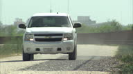 Exterior shots of a US border patrol vehicle passing along the fenced border between the Texan side of the Rio Grande and Mexico on August 27 2014 in...