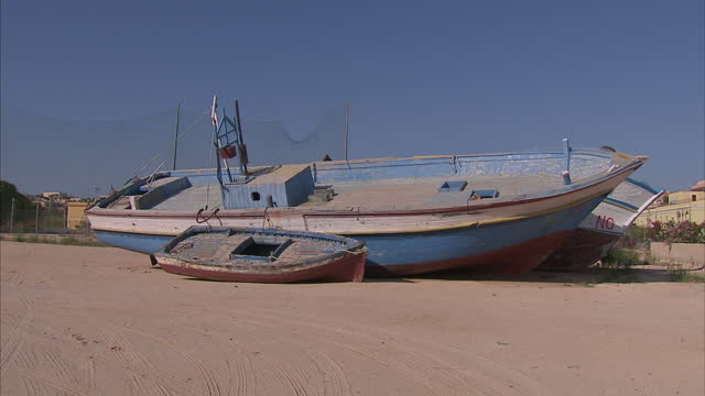Exterior shots of abandoned boats on the beach which migrants were bought into Europe with on June 23 2015 in Lampedusa Italy