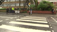 Exterior shots of Abbey Road Studios pan to zebra crossing with people walking over it on March 09 2016 in London England