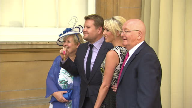 Exterior shots of actor James Corden posing holding his OBE with his parents Malcolm and Margaret Corden and his wife Julia Carey>> on June 25 2015...