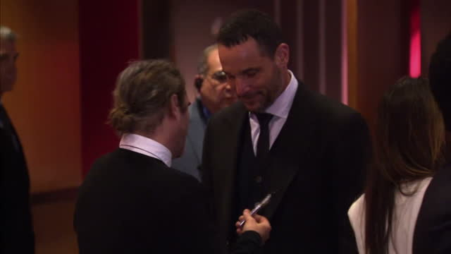 Exterior shots of actor Joaquin Phoenix replete with ponytail arriving at the Los Angeles premiere of 'Her'