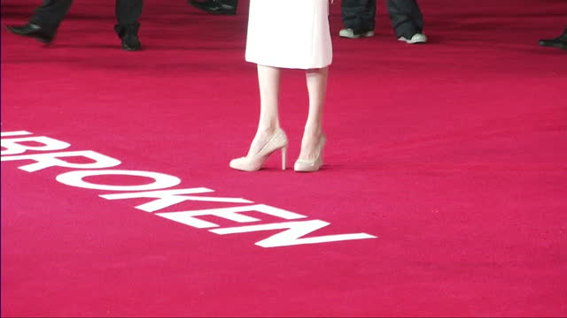 Exterior shots of actress and director Angelina Jolie posing on the red carpet at the UK premiere of 'Unbroken'>> on November 25 2014 in London...