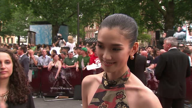 Exterior shots of actress Tao Okomoto on the red carpet at the film premiere of Wolverine at Leicester Square on July 16 2013 in London England...