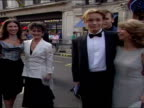 Exterior shots of Adam Rickitt posing for photos on red carpet at BAFTA awards with other Coronation Street actors Adam Rickitt pose for photo on red...