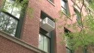 WGN Exterior shots of air conditioning window units in a school on Aug 19 2014 on Chicago Ill